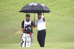 Defending champion Pat Perez of the United States of America talks to his caddie on sixteenth hole during round one of the CIMB Classic golf tournament at Tournament Players Club (TPC) in Kuala Lumpur, Malaysia, Thursday, Oct. 11, 2018. (AP Photo/Vincent Phoon)