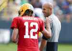 Green Bay Packers quarterback Aaron Rodgers and New York Jets head coach Robert Saleh share a laugh during a joint NFL football training camp practice Wednesday, Aug. 18, 2021, in Green Bay, Wis. (AP Photo/Matt Ludtke)
