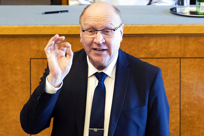 In this photo taken on Monday, April 29, 2019, Mart Helme, head of the Estonian Conservative People's Party, or EKRE, gestures while speaking during the presentation of the new government in Tallinn, Estonia. Mart Helme and his son, Finance Minister Martin Helme, were caught Monday by photographers at the ceremony making fingers gestures with their thumb and index finger to resemble a white supremacy sign. Mart Helme hasn't commented the gestures.  (Liis Treimann/Aripaev via AP)