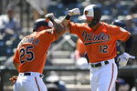 Baltimore Orioles' Stevie Wilkerson celebrates his two-run home run with Anthony Santander (25) during the seventh inning of the first baseball game of a split doubleheader, Saturday, July 13, 2019, in Baltimore. The Orioles won 2-1. (AP Photo/Nick Wass)
