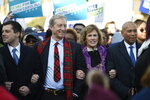 Democratic presidential contenders, from left, Pete Buttigieg, Tom Steyer, Deval Patrick and Steyer's wife Kat Taylor, second from right, link arms during a Martin Luther King Jr. march on Monday, Jan. 20, 2020, in Columbia, S.C. (AP Photo/Meg Kinnard)