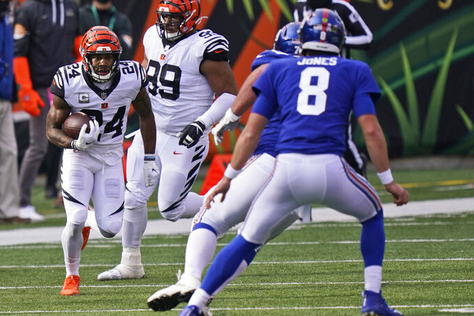 Cincinnati Bengals strong safety Vonn Bell (24) returns a fumble during the first half of an NFL football game against the New York Giants, Sunday, Nov. 29, 2020, in Cincinnati. (AP Photo/Bryan Woolston)