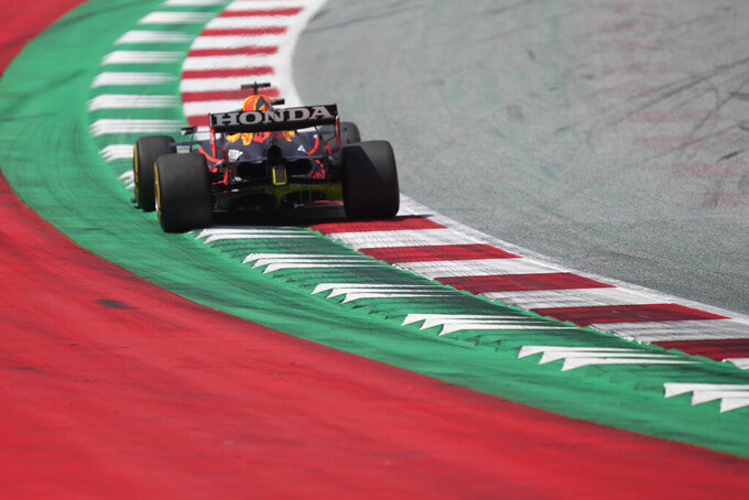 Red Bull driver Max Verstappen of the Netherlands steers his car during the first practice at the Red Bull Ring racetrack in Spielberg, Austria, Friday, June 25, 2021. The Styrian Formula One Grand Prix will be held on Sunday, June 27, 2021. (AP Photo/Darko Vojinovic)