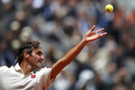 FILE - In this June 7, 2019, file photo, Switzerland's Roger Federer serves against Spain's Rafael Nadal during their semifinal match of the French Open tennis tournament at the Roland Garros stadium in Paris. Eight-time champion Roger Federer was seeded No. 2 for Wimbledon, one spot ahead of Rafael Nadal, reversing their positions in the ATP rankings and creating a debate about whether the All England Club's seeding system should be changed. (AP Photo/Christophe Ena, File)