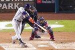 Houston Astros' Yordan Alvarez hits a two-run home run during the second inning of Game 5 of the baseball World Series against the Washington Nationals Sunday, Oct. 27, 2019, in Washington. (AP Photo/Alex Brandon)