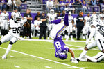 Minnesota Vikings tight end Irv Smith (84) is upended between Oakland Raiders defenders Daryl Worley, left, and Curtis Riley (35) after making a reception during the first half of an NFL football game, Sunday, Sept. 22, 2019, in Minneapolis. (AP Photo/Bruce Kluckhohn)