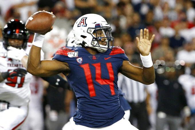 Arizona quarterback Khalil Tate (14) throws a pass against Texas Tech during the first half of an NCAA college football game Saturday, Sept. 14, 2019, in Tucson, Ariz. (AP Photo/Ralph Freso)