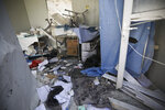 Damage from shelling is seen in hospital in Atareb, a town in rural western Aleppo, Syria, Sunday, March 22, 2021. Artillery shells fired from government areas killed at least five civilians and wounded medical staff when they landad in front of the hospital. (AP Photo/Ghaith Alsayed)