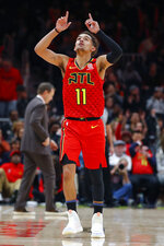 Atlanta Hawks guard Trae Young (11) reacts after landing a three pointer during the second half of an NBA basketball game against the Washington Wizards on Sunday, Jan. 26, 2020, in Atlanta. (AP Photo/Todd Kirkland)