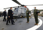 French President Emmanuel Macron meets crew members of a NH90 Caiman helicopter prior to his New Year's speech to the French Armed Forces at Brest naval training center, western France, Tuesday, Jan. 19, 2021. (Stephane Mahe/Pool Photo via AP)
