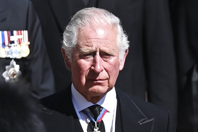 Britain's Prince Charles sheds a tear as he follows the coffin as it makes it's way past the Round Tower during the funeral of Britain's Prince Philip inside Windsor Castle in Windsor, England Saturday April 17, 2021. (Leon Neal/Pool via AP)