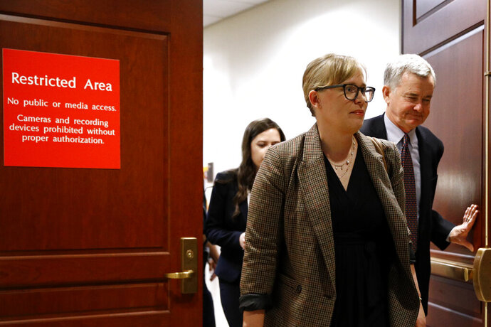 Catherine Croft, a State Department adviser on Ukraine, departs a secure area of the Capitol after a closed door meeting where she testified as part of the House impeachment inquiry into President Donald Trump, Wednesday, Oct. 30, 2019, on Capitol Hill in Washington. (AP Photo/Patrick Semansky)