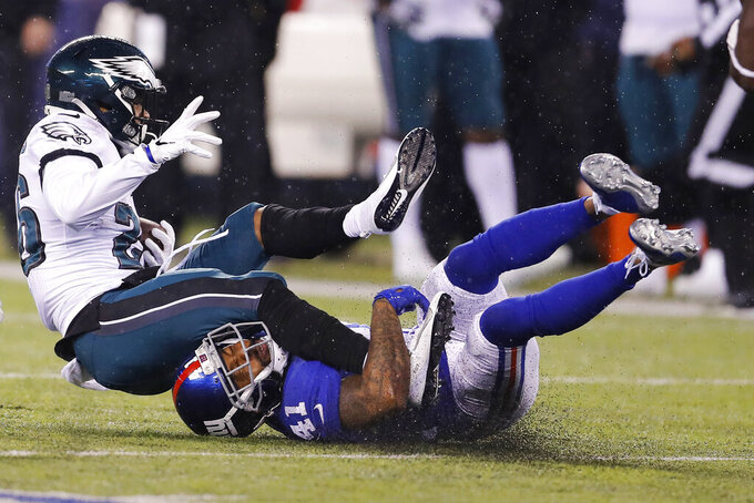 New York Giants free safety Antoine Bethea (41) stops Philadelphia Eagles running back Miles Sanders (26) in the first half of an NFL football game, Sunday, Dec. 29, 2019, in East Rutherford, N.J. (AP Photo/Adam Hunger)