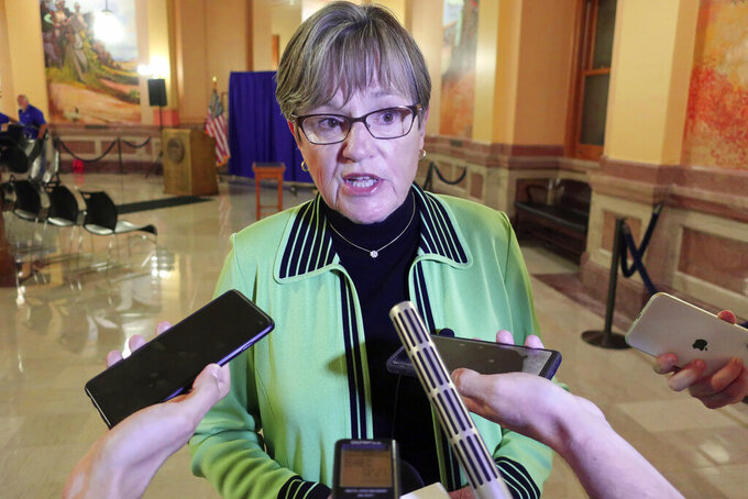 Kansas Gov. Laura Kelly answers questions from reporters following an event at the Statehouse, Thursday, July 22, 2021, in Topeka, Kan. Kelly says getting more Kansas residents vaccinated is the only way to stop the spread of the COVID-19 delta variant. (AP Photo/John Hanna)
