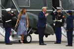 President Donald Trump and first lady Melania Trump walk off Marine One to board Air Force One for a trip to attend the SpaceX Demonstration Mission 2 Launch at Kennedy Space Center, Wednesday, May 27, 2020, in Andrews Air Force Base, Md. (AP Photo/Susan Walsh)