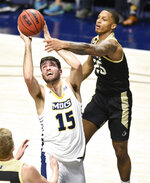 Chattanooga's Ramon Vila (15) grabs a rebound in front of Wofford's Messiah Jones (25) during an NCAA college basketball game Wednesday, Jan. 15, 2020, in Chattanooga, Tenn. (Robin Rudd/Chattanooga Times Free Press via AP)