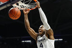Xavier's Tyrique Jones dunks during the first half of an NCAA college basketball game against Seton Hall, Wednesday, Jan. 8, 2020, in Cincinnati. (AP Photo/John Minchillo)
