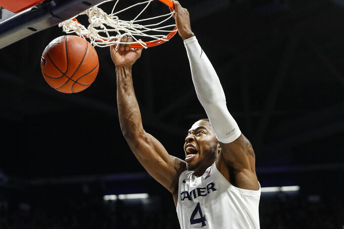 Xavier's Tyrique Jones dunks during the first half of an NCAA college basketball game against Seton Hall, Wednesday, Jan. 8, 2020, in Cincinnati. (AP Photo/John Minchillo)