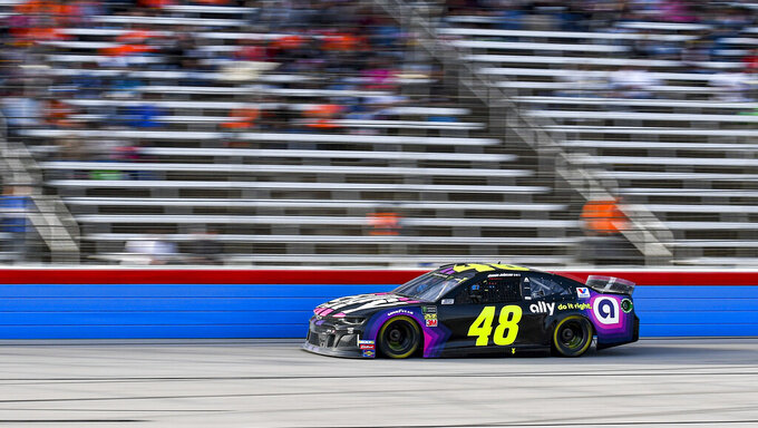 Jimmie Johnson (48) races down the front stretch during a NASCAR Cup Series auto race at Texas Motor Speedway, Sunday, Nov. 3, 2019, in Fort Worth, Texas. (AP Photo/Randy Holt)