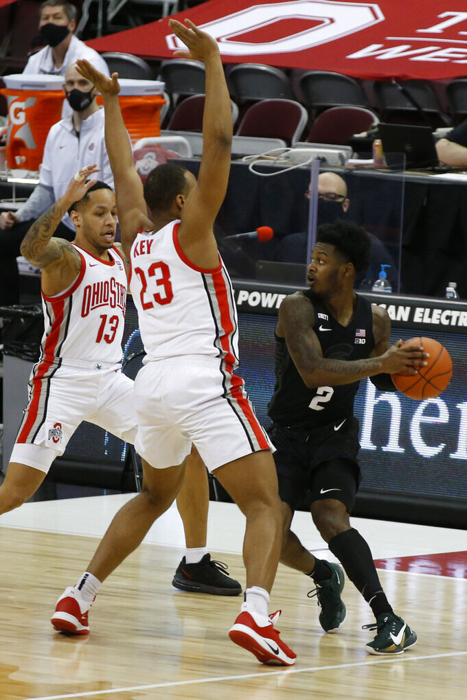 Ohio State's C.J. Walker, left, and Zed Key, center, trap Michigan State's Rocket Watts at half court during the first half of an NCAA college basketball game Sunday, Jan. 31, 2021, in Columbus, Ohio. (AP Photo/Jay LaPrete)