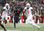 Illinois quarterback AJ Bush Jr. runs with the ball as Rutgers linebacker Trevor Morris (5) gives chase during the second half of an NCAA college football game Saturday, Oct. 6, 2018, in Piscataway, N.J. Illinois won 38-17. (AP Photo/David Boe)