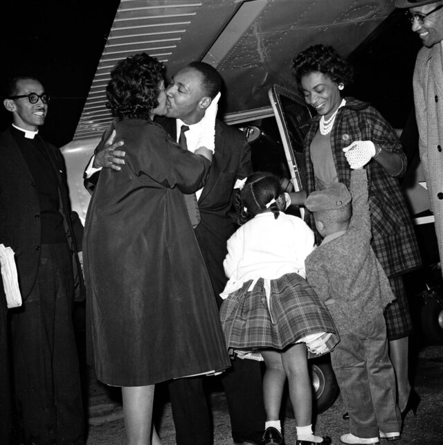FILE - In this Oct. 27, 1960 file photo, Martin Luther King Jr. is given a kiss by his wife Coretta as he is welcomed back from Georgia's Reidsville State Prison by demonstrators and family gathered at the DeKalb Peachtree Airport. Following the publication of