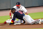 Washington Nationals' Victor Robles steals third base as Atlanta Braves' Austin Riley tries to make a tag during the first inning of a baseball game Saturday, Sept. 5, 2020, in Atlanta. (AP Photo/John Amis)