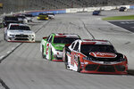 Christopher Bell (20) and Tyler Reddick (2) head into Turn 1 during the NASCAR Xfinity Series auto race at Texas Motor Speedway in Fort Worth, Texas, Saturday, Nov. 2, 2019. (AP Photo/Larry Papke)