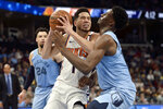 Phoenix Suns guard Devin Booker (1) drives against Memphis Grizzlies forward Jaren Jackson Jr., right, in the second half of an NBA basketball game Sunday, Jan. 26, 2020, in Memphis, Tenn. (AP Photo/Brandon Dill)