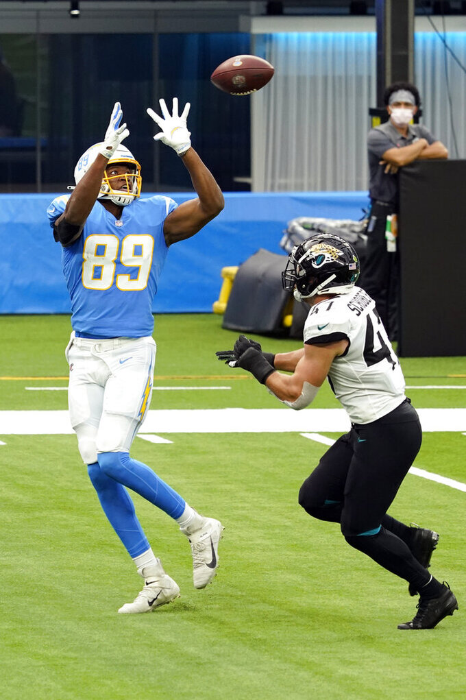 Los Angeles Chargers tight end Donald Parham (89) makes a touchdown catch over Jacksonville Jaguars middle linebacker Joe Schobert during the first half of an NFL football game Sunday, Oct. 25, 2020, in Inglewood, Calif. (AP Photo/Alex Gallardo )