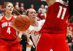 Stanford's Lexie Hull, center, loses control of the ball between Ohio State's Jacy Sheldon (4) and Aixa Wone Aranaz during the first half of an NCAA college basketball game Sunday, Dec. 15, 2019, in Stanford, Calif. (AP Photo/George Nikitin)