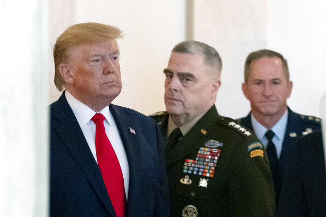 President Donald Trump arrives to address the nation from the White House on the ballistic missile strike that Iran launched against Iraqi air bases housing U.S. troops, Wednesday, Jan. 8, 2020, in Washington, accompanied by Joint Chiefs Chairman Gen. Mark Milley, center, and U.S. Air Force Chief of Staff Gen. David L. Goldfein. (AP Photo/Alex Brandon)