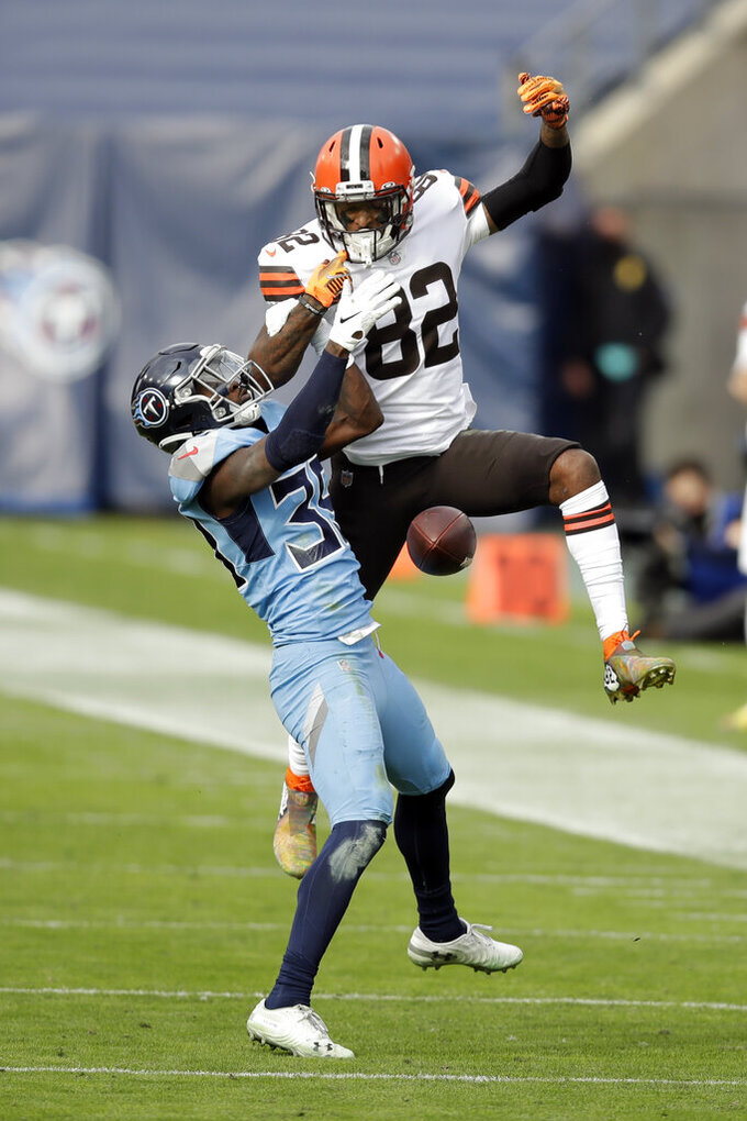 Tennessee Titans cornerback Breon Borders (39) breaks up a pass intended for Cleveland Browns wide receiver Rashard Higgins (82) in the first half of an NFL football game Sunday, Dec. 6, 2020, in Nashville, Tenn. (AP Photo/Ben Margot)