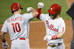 Philadelphia Phillies' Bryce Harper (3) celebrates his home run with J.T. Realmuto (10) during the sixth inning of the team's baseball game against the Washington Nationals, Wednesday, Sept. 23, 2020, in Washington. This was Harper's second homer of the night. (AP Photo/Nick Wass)