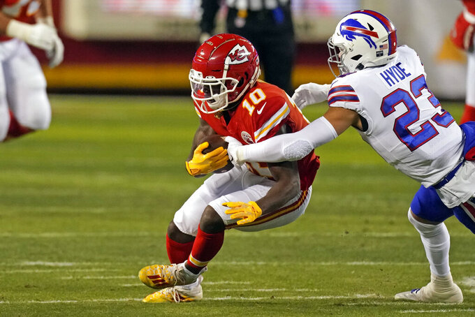 Kansas City Chiefs wide receiver Tyreek Hill (10) catches a pass ahead of Buffalo Bills safety Micah Hyde (23) during the first half of the AFC championship NFL football game, Sunday, Jan. 24, 2021, in Kansas City, Mo. (AP Photo/Charlie Riedel)