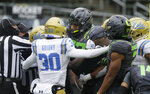 UCLA and Oregon players get into a posing match during the first quarter of an NCAA college football game Saturday, Nov. 21, 2020, in Eugene, Ore. (AP Photo/Chris Pietsch)