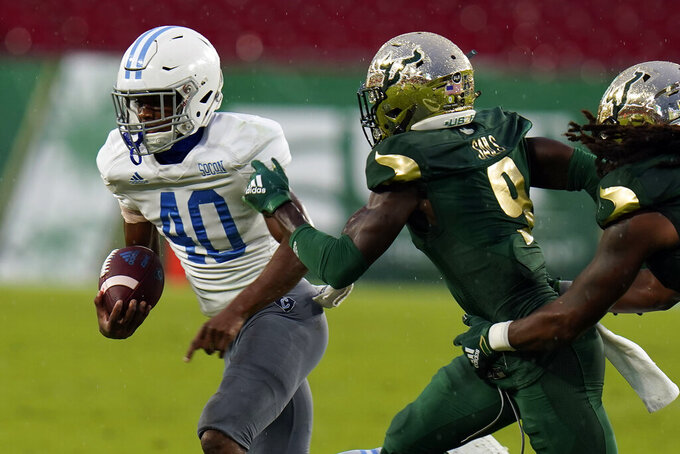 Citadel running back Darique Hampton (40) sidesteps a tackle by South Florida defensive back KJ Sails (9) during the first half of an NCAA college football game Saturday, Sept. 12, 2020, in Tampa, Fla. (AP Photo/Chris O'Meara)