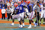 Florida running back Dameon Pierce, left, celebrates his touchdown run against Alabama with offensive lineman Jean Delance (56) and offensive lineman Stewart Reese, right, during the second half of an NCAA college football game, Saturday, Sept. 18, 2021, in Gainesville, Fla. (AP Photo/John Raoux)