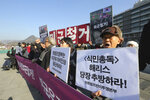 Protesters stage a rally to denounce a recent U.S. Ambassador Harry Harris's briefing near the U.S. embassy in Seoul, South Korea, Monday, Jan. 20, 2020. Harris has some unusual explanations for the harsh criticism he's faced in his host country. His mustache, maybe? Or a Japanese ancestry that raises unpleasant reminders of Japan's former colonial domination of Korea? The sign reads