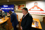 Former Secretary of State Mike Pompeo bows his head in prayers before speaking at the West Side Conservative Club, Friday, March 26, 2021, in Urbandale, Iowa. (AP Photo/Charlie Neibergall)