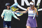 Denmark's Caroline Wozniacki throws a towel towards a ballboy during her first round match against United States' Kristie Ahn at the Australian Open tennis championship in Melbourne, Australia, Monday, Jan. 20, 2020. (AP Photo/Andy Wong)