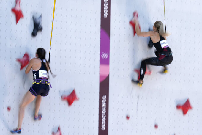 Kyra Condie, left, of the United States, races against Aleksandra Miroslaw, of Poland, during the speed qualification portion of the women's sport climbing competition at the 2020 Summer Olympics, Wednesday, Aug. 4, 2021, in Tokyo, Japan. (AP Photo/Jeff Roberson)