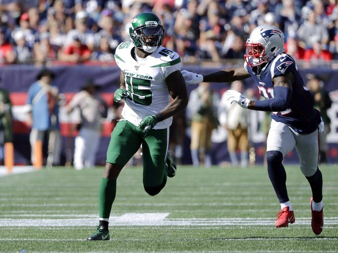 FILE - In this Sunday, Sept. 22, 2019 file photo, New York Jets wide receiver Josh Bellamy runs a pass route as New England Patriots defensive back Jonathan Jones (31) gives chase in the second half of an NFL football game in Foxborough, Mass.  A person with direct knowledge of the decision says the New York Jets are placing wide receivers Quincy Enunwa and Josh Bellamy on the reserve/physically unable to perform list. The moves Tuesday, May 5, 2020 effectively end each of the player's seasons with the Jets, four months before the season opener is scheduled. (AP Photo/Steven Senne, File)