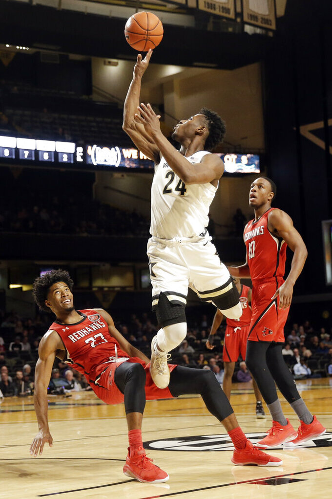 Vanderbilt forward Aaron Nesmith (24) shoots over Southeast Missouri State forward Sage Tolbert (23) in the second half of an NCAA college basketball game Wednesday, Nov. 6, 2019, in Nashville, Tenn. (AP Photo/Mark Humphrey)