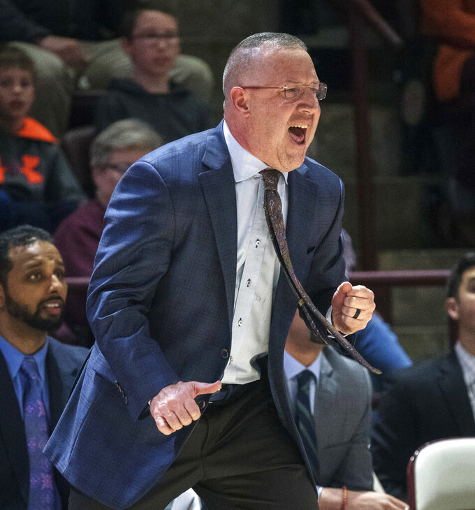 FILE - In this Dec. 5, 2018, file photo, Virginia Tech head coach Buzz Williams yells to his players during the first half of an NCAA college basketball game against VMI, in Blacksburg, Va. Virginia Tech is enjoying one of the best starts to a basketball season in program history, and one of the keys to the Hokies' success has been an increased attention to defense.(AP Photo/Don Petersen, File)