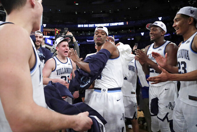 Villanova forward Brandon Slater, center, celebrates with teammates after defeating Seton Hall 74-72 in an NCAA college basketball game in the championship of the Big East Conference tournament, Saturday, March 16, 2019, in New York. (AP Photo/Julio Cortez)