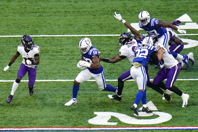 Indianapolis Colts inside linebacker Bobby Okereke (58) runs after recovering a fumble against the Baltimore Ravens in the second half of an NFL football game in Indianapolis, Sunday, Nov. 8, 2020. (AP Photo/AJ Mast)