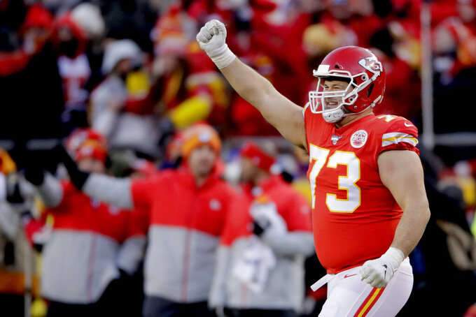 Kansas City Chiefs' Nick Allegretti celebrates during the second half of the NFL AFC Championship football game against the Tennessee Titans Sunday, Jan. 19, 2020, in Kansas City, MO. (AP Photo/Charlie Riedel)