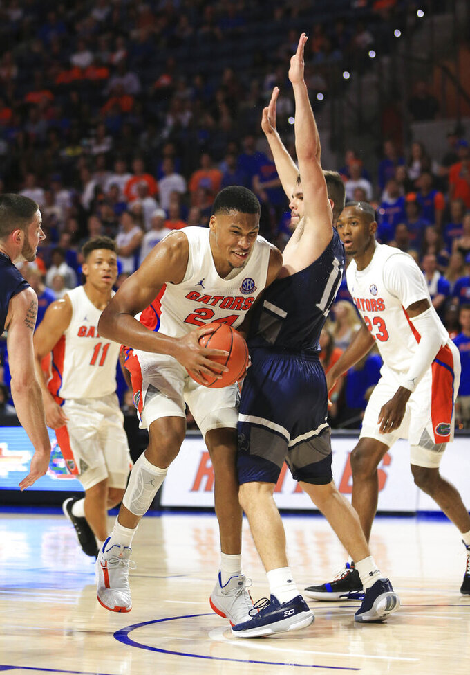 Florida forward Kerry Blackshear Jr. (24) goes to the basket against North Florida guard Ivan Gandia-Rosa (10) during the second half of an NCAA college basketball game Tuesday, Nov. 5, 2019, in Gainesville, Fla. (AP Photo/Matt Stamey)
