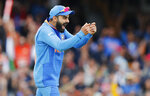 India's captain Virat Kohli celebrates after winning the Cricket World Cup match between India and Australia at the Oval in London, Sunday, June 9, 2019.(AP Photo/Frank Augstein)